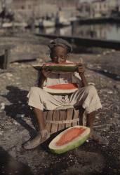 Portrait informel d'un jeune garçon mageant de la pastèque (Edwin L. Wisherd) - Muzeo.com