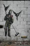 Graffiti d'homme balayant des balles (Umberto anonyme) - Muzeo.com